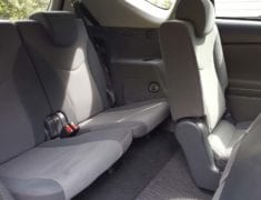 Spacious Interior of 7 seater Toyota Prius Alpha Stationwagon with Push/Pull Hand Controls
